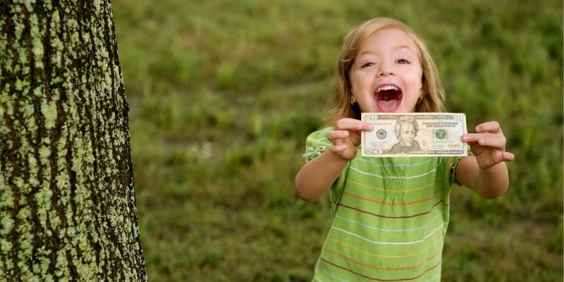 earn money as kid little girl holding money