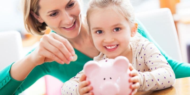 mom teaching kid about saving money