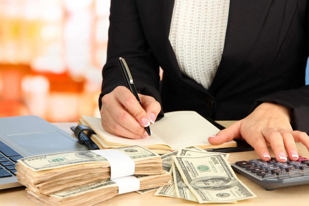 woman in suit accounting