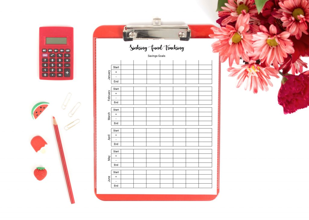tracking sinking funds printable on red clipboard