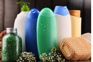Bottles of shampoo and lotions. Use up what you already have to save money and live more frugal